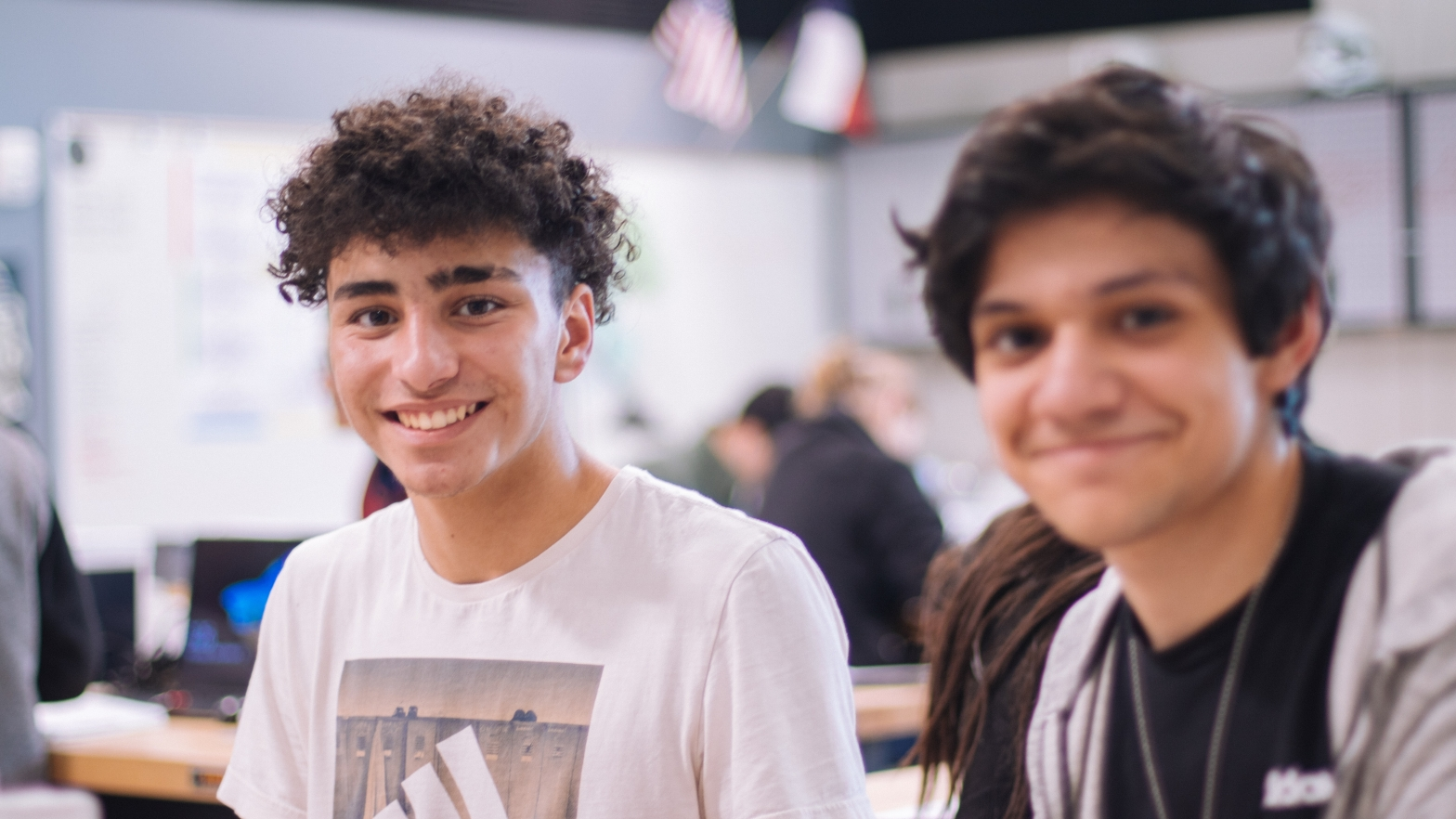 two young people smiling at the camera